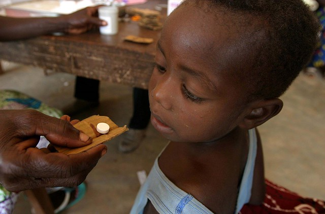 A little boy from the Goba tribe receiving a dose of medicine in Lusaka, Zambia