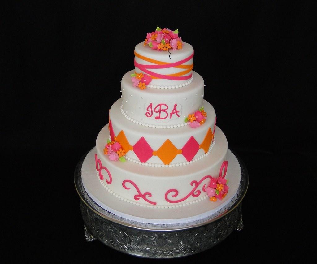 Hot pink and orange wedding cake cakesbyelisa