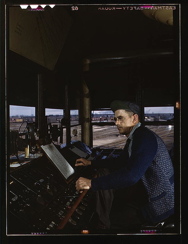 C&NWRR, towerman R.W. Mayberry of Elmhurst, Ill., at the Proviso yard. He operates a set of retarders and switches at the hump, Melrose Park (near Chicago), Ill.  (LOC) | by The Library of Congress