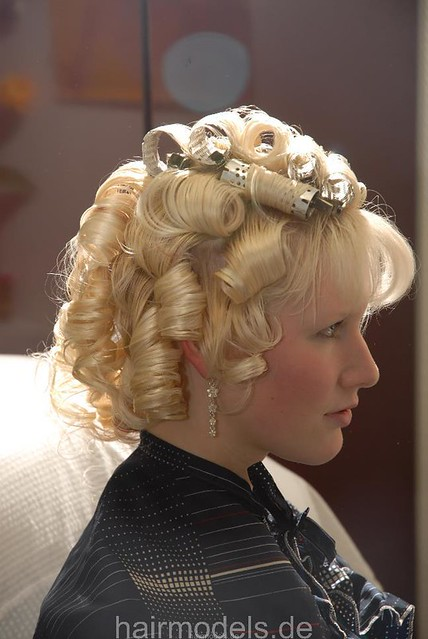 Blonde Beauty Striking Color With The Rollers Being