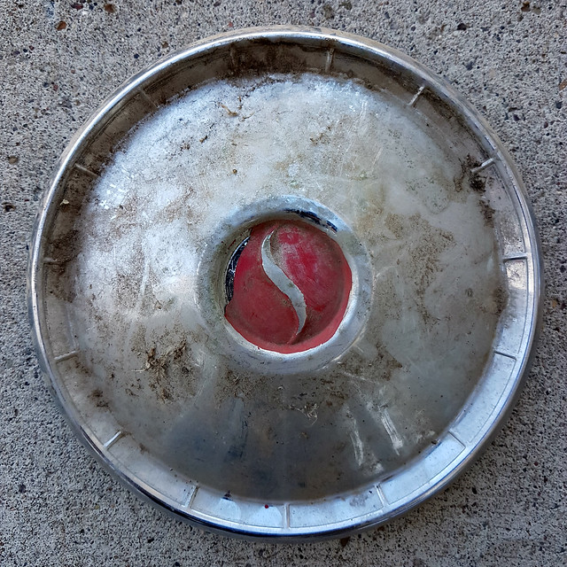 Studebaker hubcap before