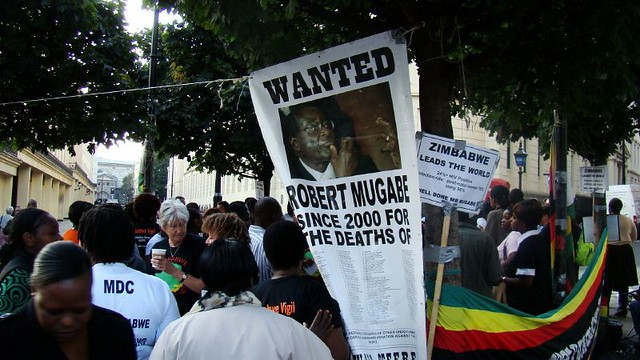 A group of Zimbabwe expatriates protest against the dictator Mugabe outside the Zimbabwe embassy.