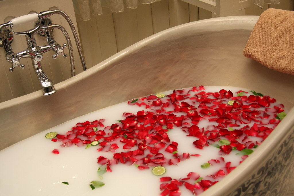 Image result for rose petals in tub
