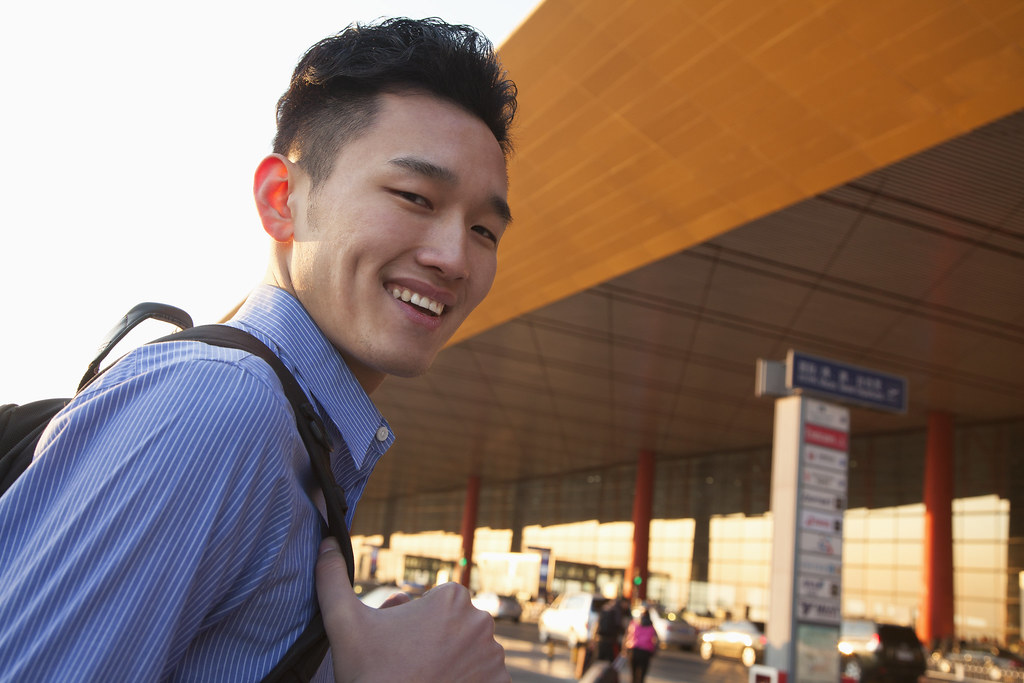 male student at airport