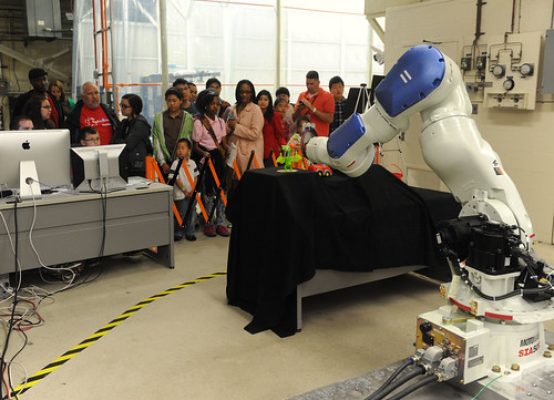 Explore@NASA Goddard   Visitors control a robotic arm on ...