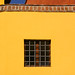 A Window in a Yellow Wall