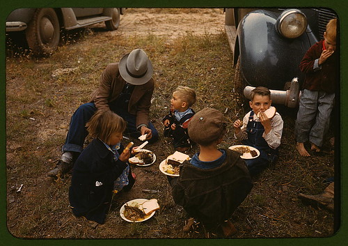 Homesteader and his children eating barbeque at the Pie Town, New Mexico Fair  (LOC) | by The Library of Congress
