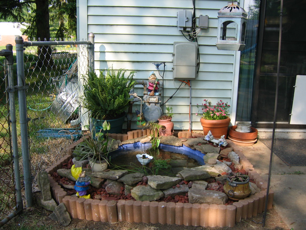 Patio pond made from old plastic swimming pool took old for Plastic backyard ponds