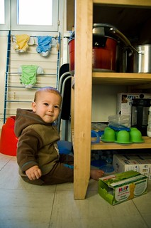 This kid doesn't need toys. He has tupperware and empty boxes. And he loves it! | by PutYourFlareOn