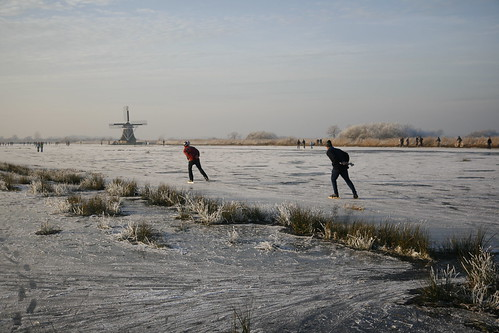 Ice skating in Friesland with mill | by Paul van Eijden™