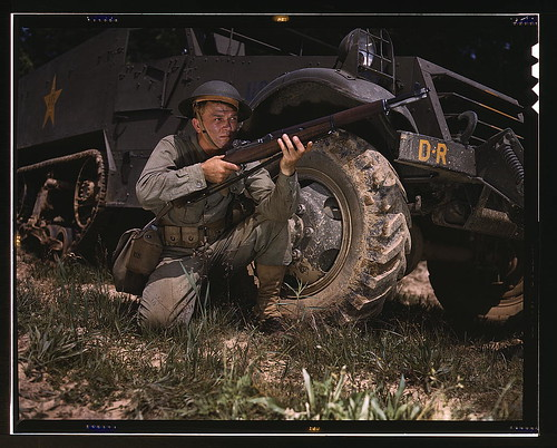 Infantryman with halftrack, a young soldier of the armed forces, holds and sights his Garand rifle like an old timer, Fort Knox, Ky. He likes the piece for its fine firing qualities and its rugged, dependable mechanism.  (LOC) | by The Library of Congress