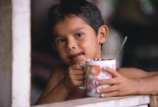 Young boy takes a drink of homemade cocoa. Brazil | by World Bank Photo Collection