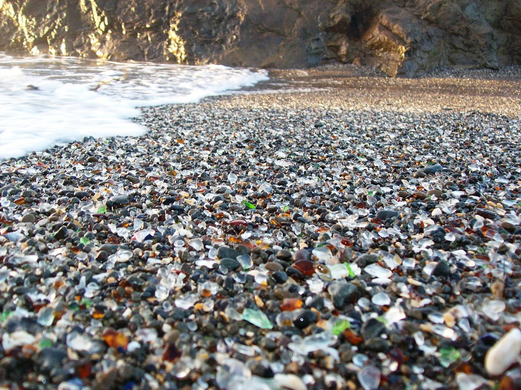 Close-up view of the colored glass beads mixed in the sand at Glass Beach near Fort Bragg, CA (glassbeach36xy)