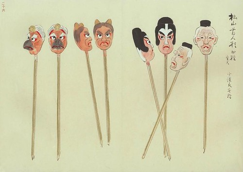 angry toy heads on sticks | by peacay