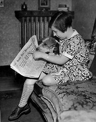 Dog reading newspaper | by SnapShot1951