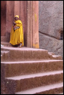 A mustard-robed monk at St George's church in Lalibela | by CharlesFred