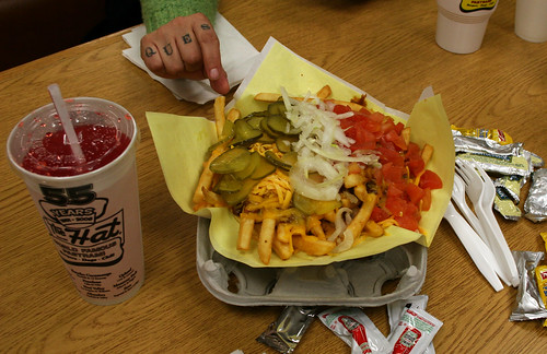 Chili Cheese Fries with tomatoes, pickles and onion at The Hat | by Marshall Astor - Food Fetishist