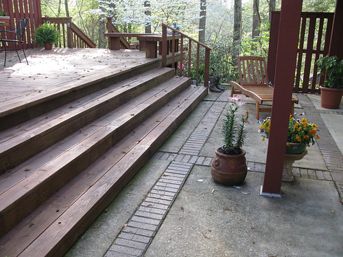 Steps to the main deck from lower patio at the back corner ...