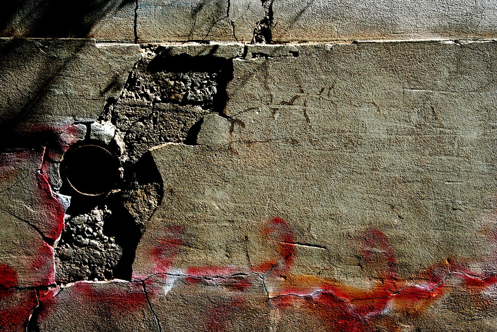 Cement Wall Graffiti : Drain pipe in crumbling cement wall with graffiti bisbee