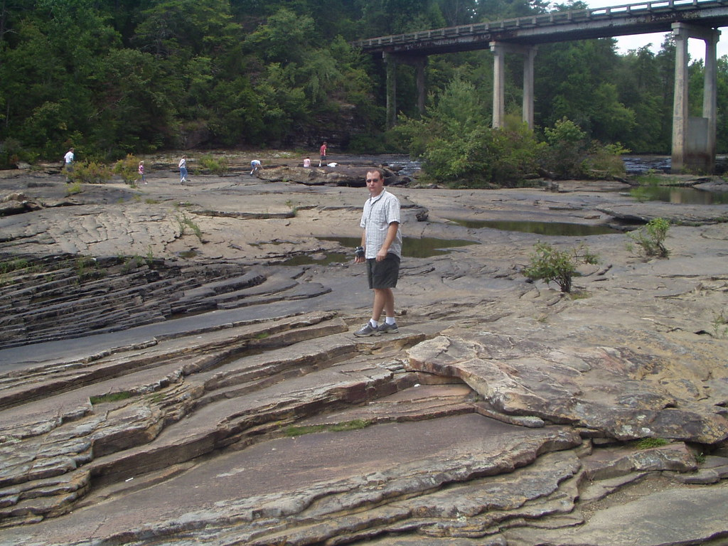 Danny walks atop the water carved bedrock little rive