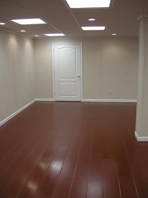 Waterproof hardwood flooring by total basement finishing for Hardwood floors in basement