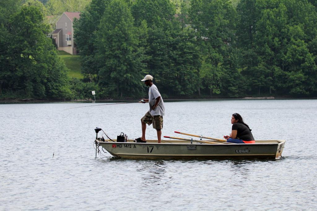 Couple fishing on little seneca lake fishing appears to for Seneca lake fishing report
