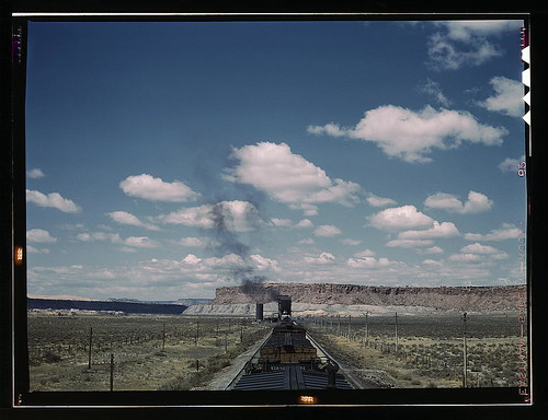 A Freight Train Stopping For Coal And Water At A Siding En