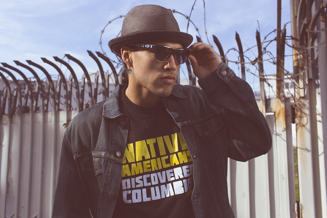 Jared Yazzie (Diné [Navajo]) for OxDx, Native Americans Discovered Columbus t-shirt, 2012. The Smithsonian's National Museum of the American Indian's Native Fashion Now Exhibit. Photo by Thosh Collins.