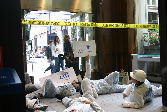 Protestors lie in front of bank entrance
