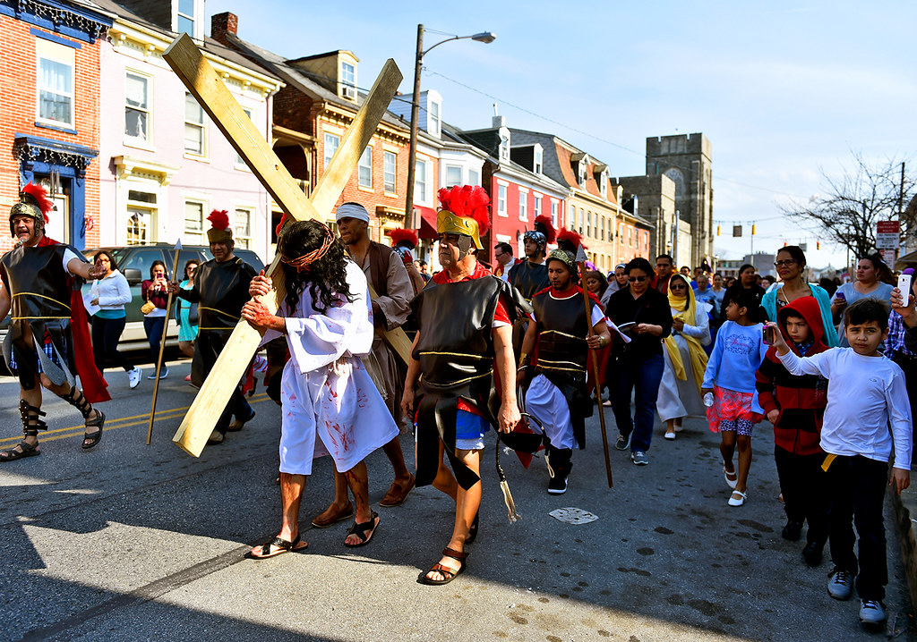 © 2016 by The York Daily Record/Sunday News. Carrying a cross of 2x4 planks, Jesús Solorio performs as Jesus Christ as he and others walk down South Queen Street during a Good Friday street procession held by the Immaculate Conception of the Blessed Virgin Mary Church Friday, March 25, 2016, in York.