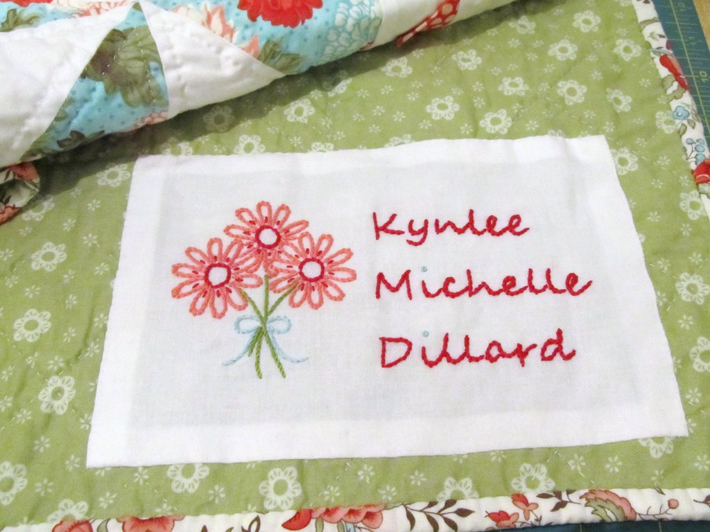 Quilt label hand embroidered pattern from