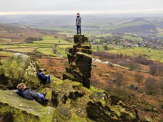 Sam on the Curbar Edge pinnacle stone