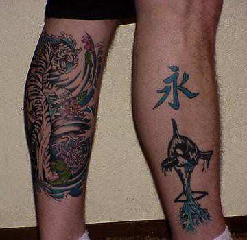 Mike's tattoo's-right=Eternity and Shamu, left tiger climb ...