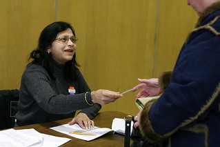 Shelat Raksha checks voters in during Super Tuesday | by WNPR - Connecticut Public Radio