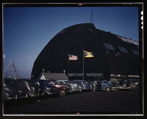 Formerly an aircraft dock, this huge building -- thought to be the largest in the world with no interior supports -- is now the scene of many busy shops turning out aircraft sub-assembly parts, Goodyear Aircraft Corp., Akron, Ohio. Either new housing clos | by The Library of Congress