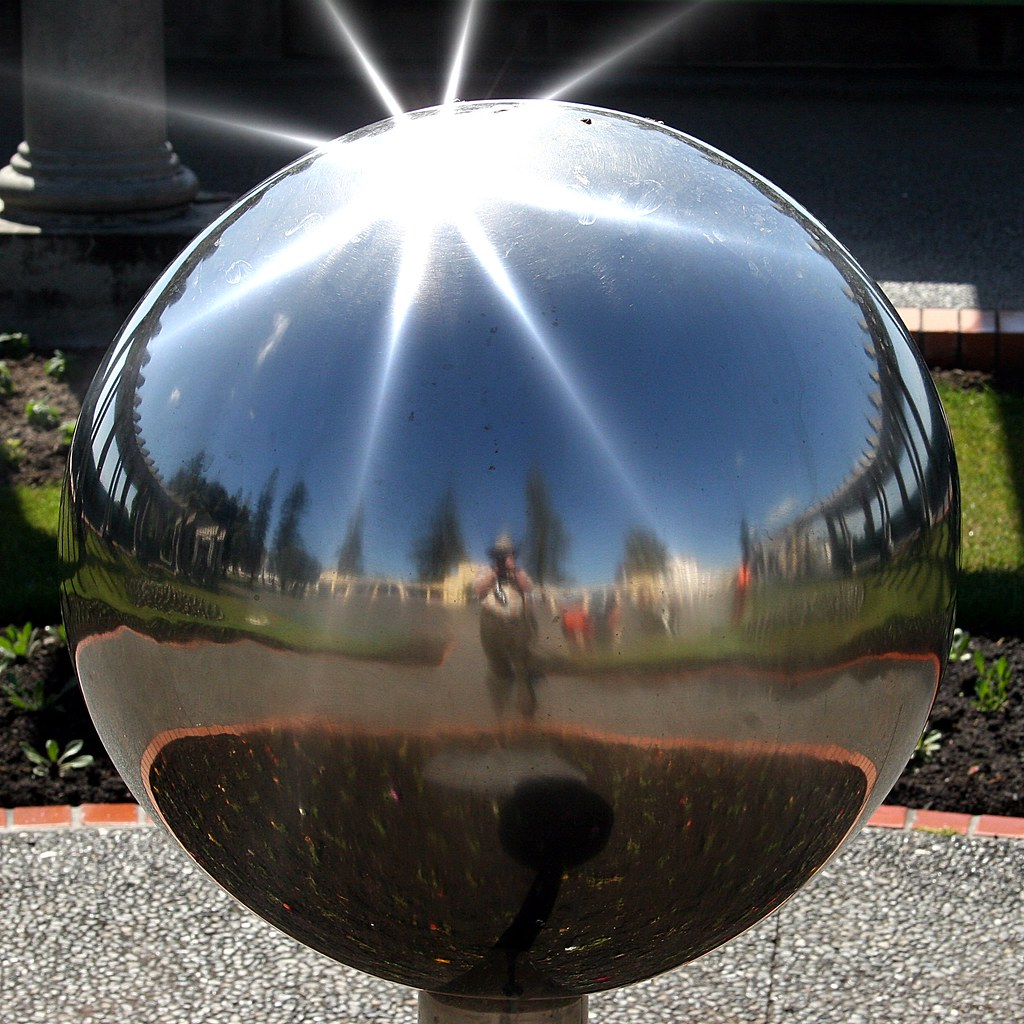 mirror globe a reflection of the photographer caught in t flickr