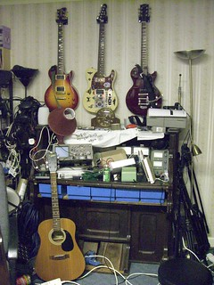 some guitars above a gutted pianola | by :: Wendy ::
