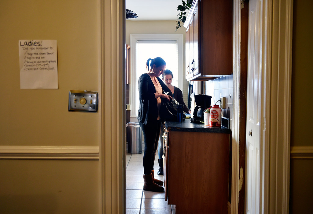 © 2016 by The York Daily Record/Sunday News. Nicole Anderson, 27, of Fairfax, Va., left, gets ready to go to work as Jenna Weaver, 24, of Carlisle, helps prepare dinner in a Pennsylvania Avenue home operated by Choices Recovery House, on Thursday, Jan. 28, 2016. The home is one of three female recovery houses operated by Choices, which also runs two male houses.