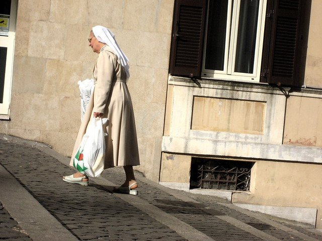 A nun climbing stairs near the Vatican