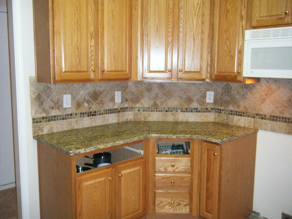 Santa Cecilia Granite With Customtile Backsplash Design In