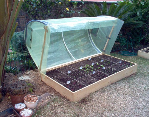 6 Bottom frame is fastened to the raised bed with hinges