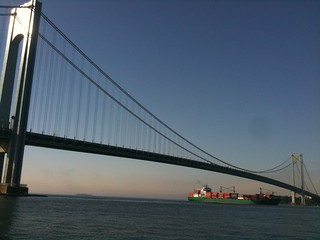 container ship passing under the verrazano narrows bridge