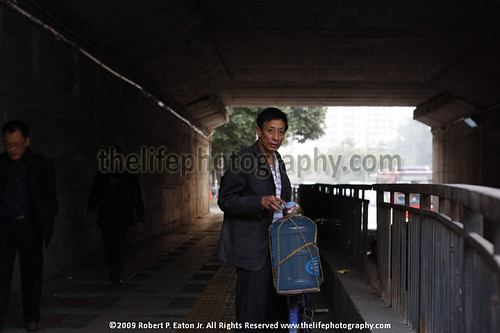 Water Delivery man standing under bridge | by thecenterofthenet.com