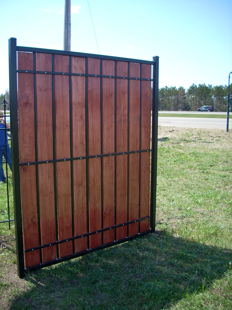 Metal and wood privacy fence our newest