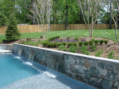 Backyard swimming pool landscape m m professional for Pool design retaining wall