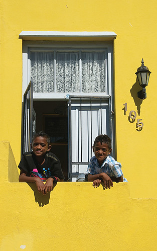 two little boys in front of their home in the colorful Bo Kapp C | by jitenshaman
