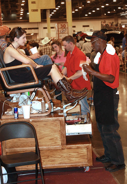 Cowgirl Getting A Boot Shine Houston Livestock Show And