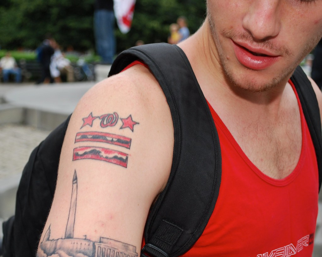 capital designs a guy with a dc flag tattoo and a dc