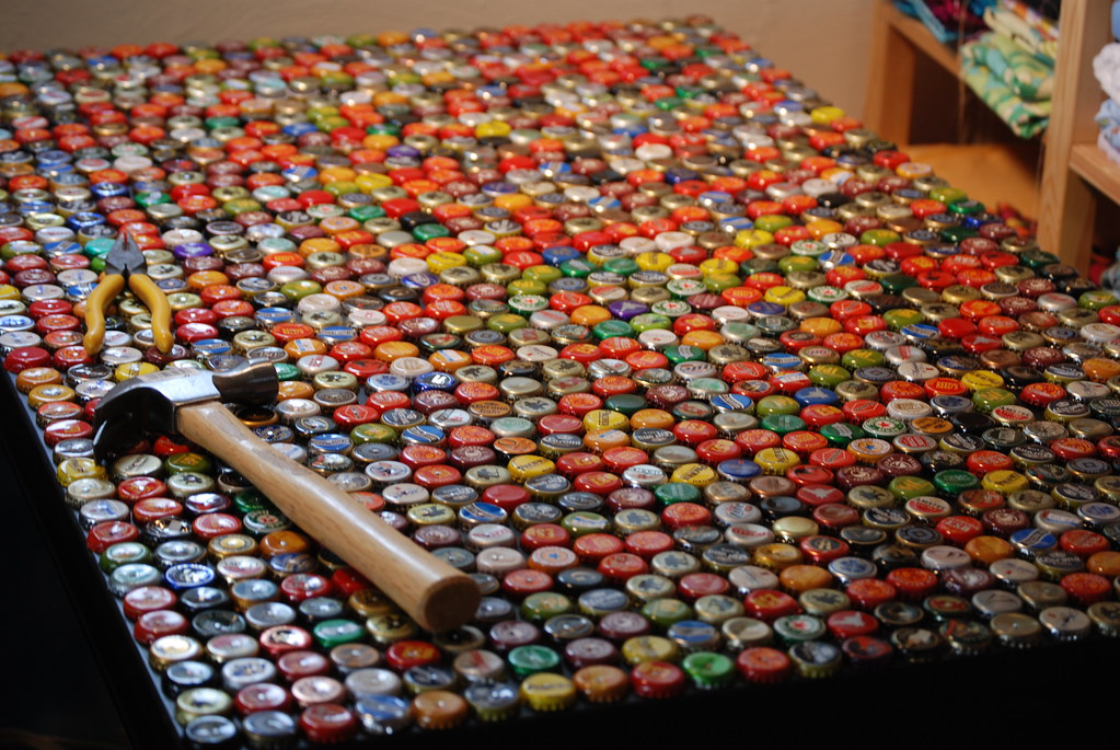 Dsc 0646 this is a table top that i have covered with for How to make beer bottle cap art
