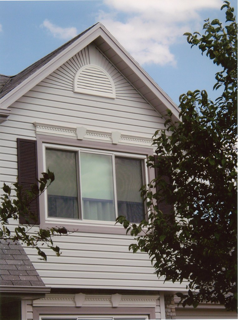 Dutchlap vinyl siding with starburst in gable | This ...